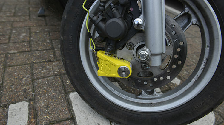 Motorcycle disc lock fitted to wheel of boke