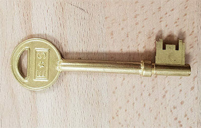 a large gold mortice key