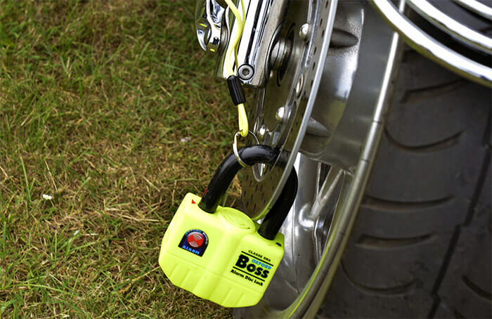 A motorcycle disc lock alarm fitted to motorcycle wheel